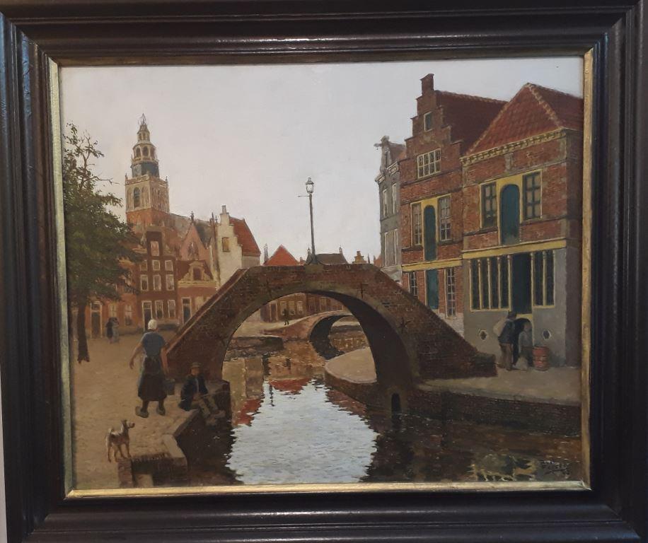 Stadsgezicht van gouda, gracht met bruggetje